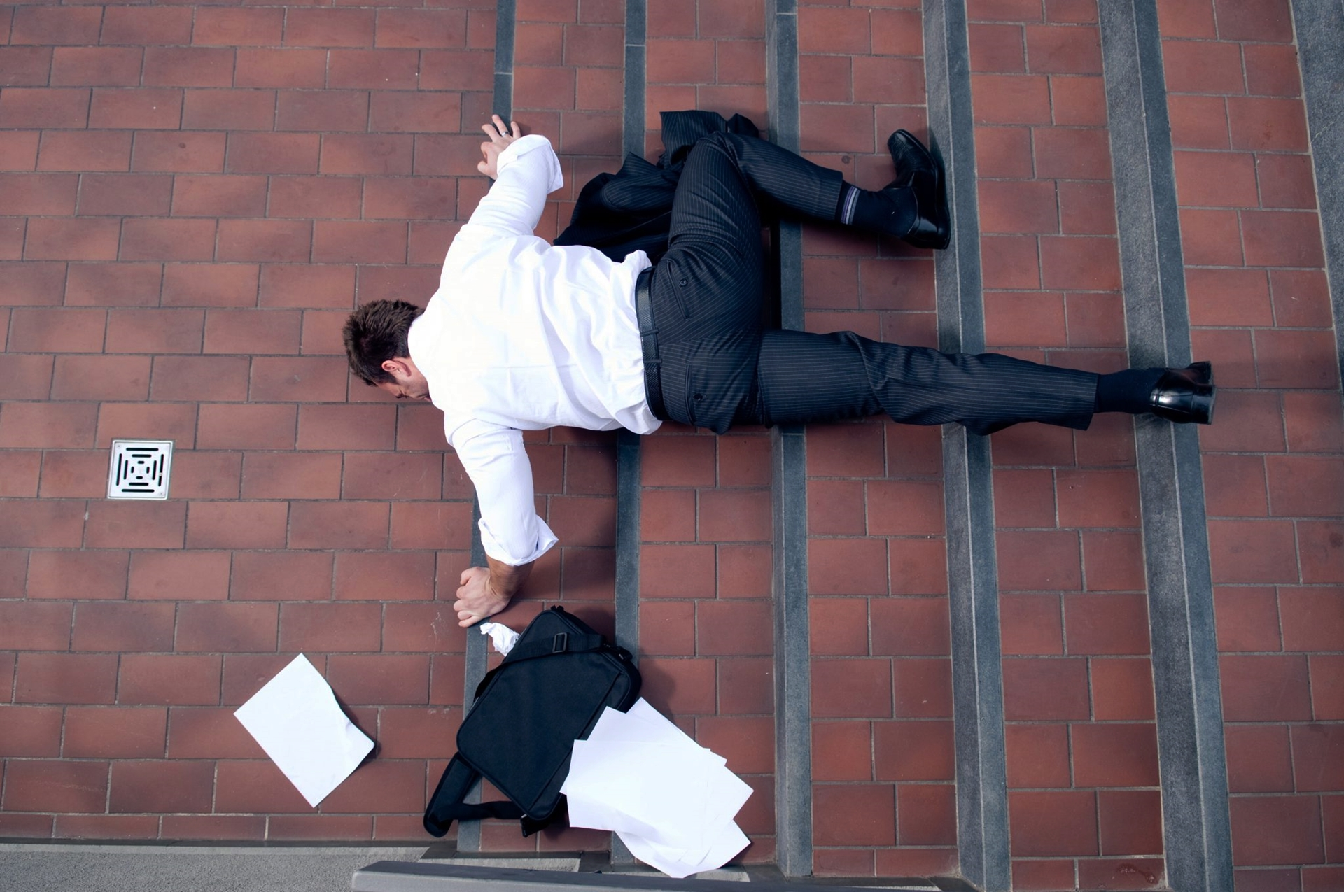 Business man falling in stairs