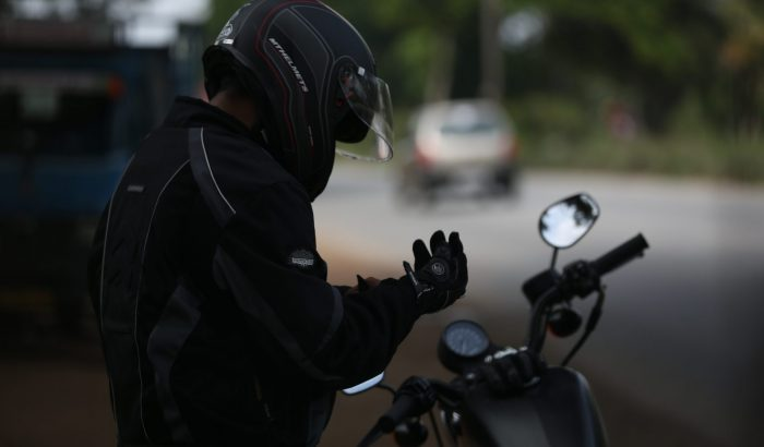 Man putting gloves before a motorbike ride