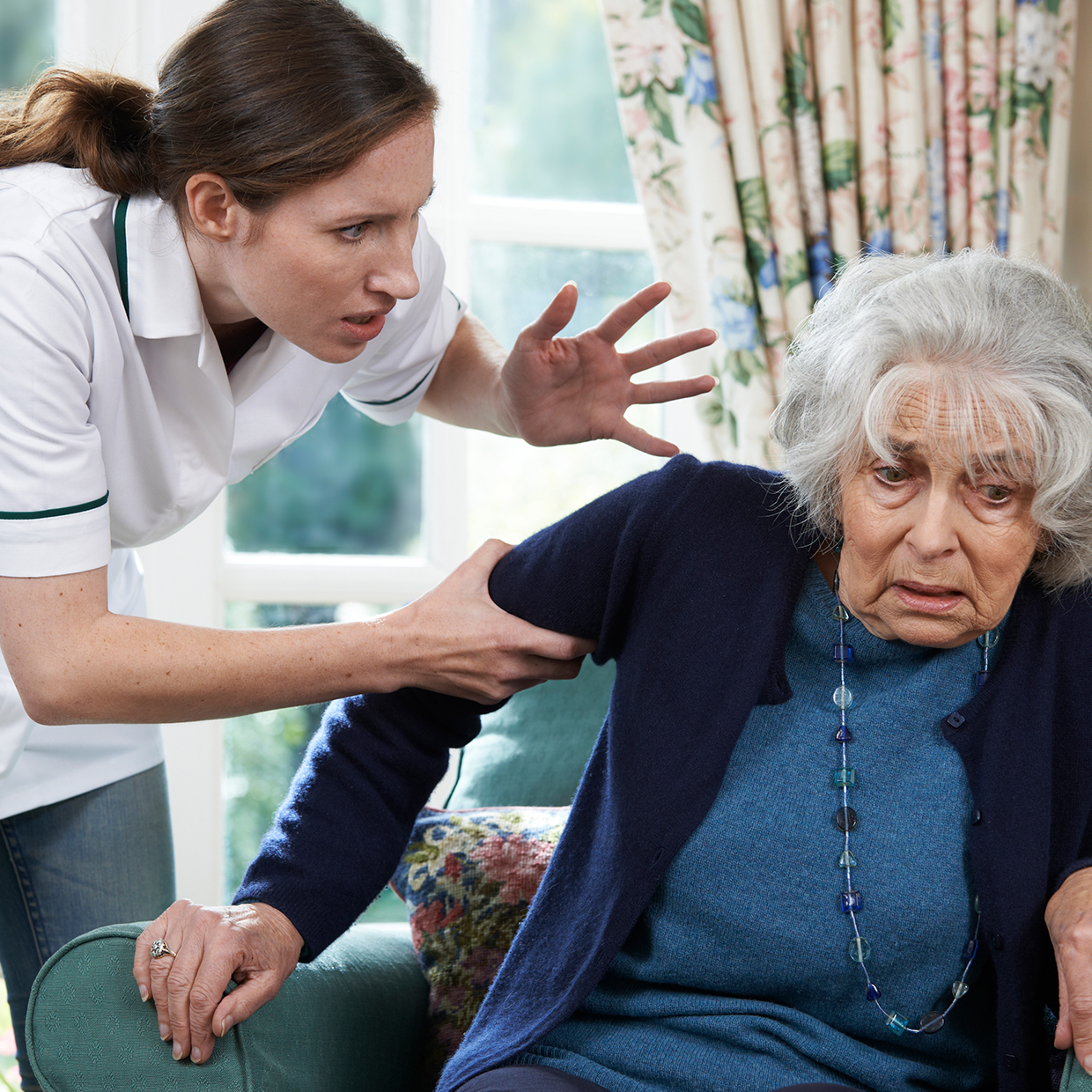 Nurse grabbing elder woman and screaming at her