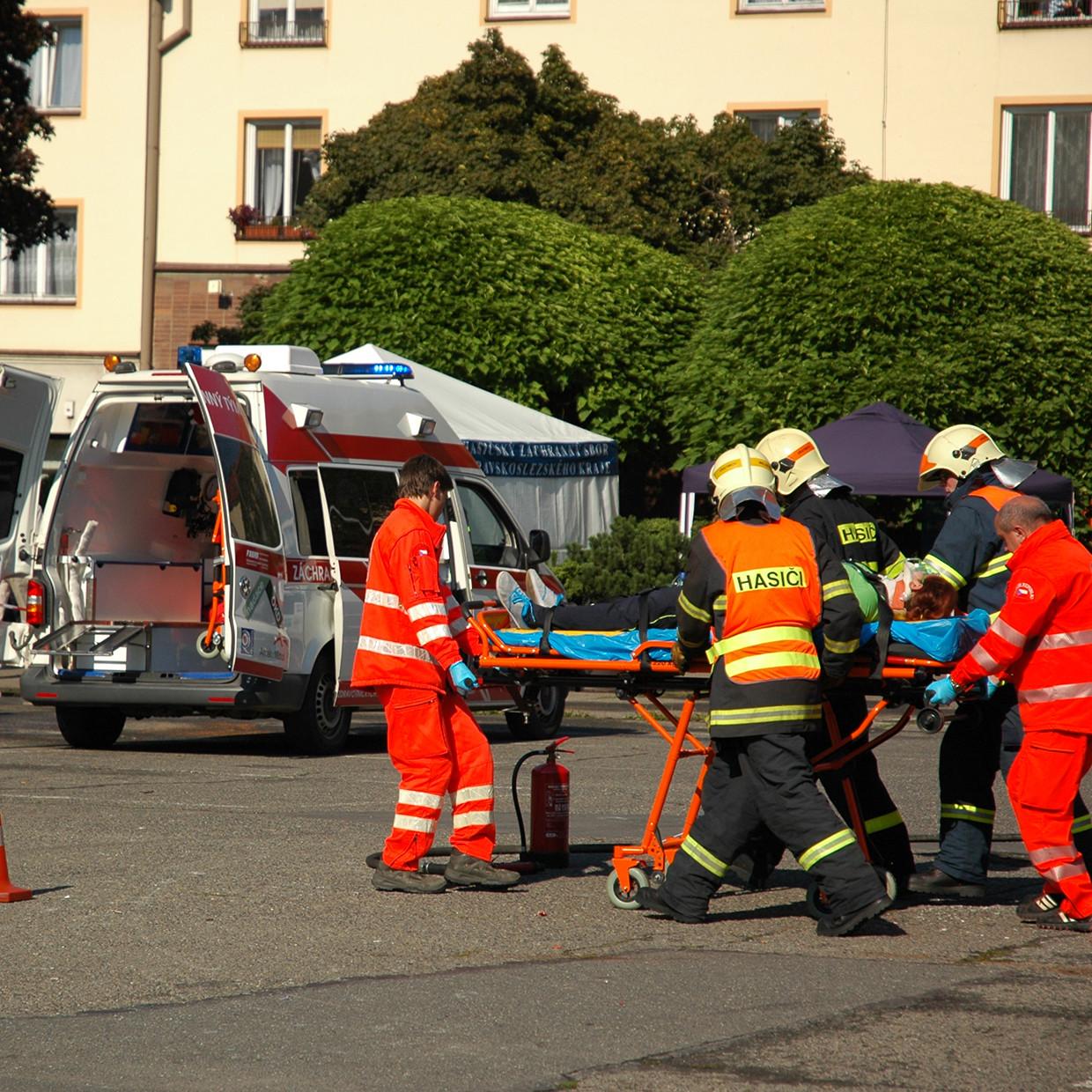 Paramedics and firefighters assisting a victim