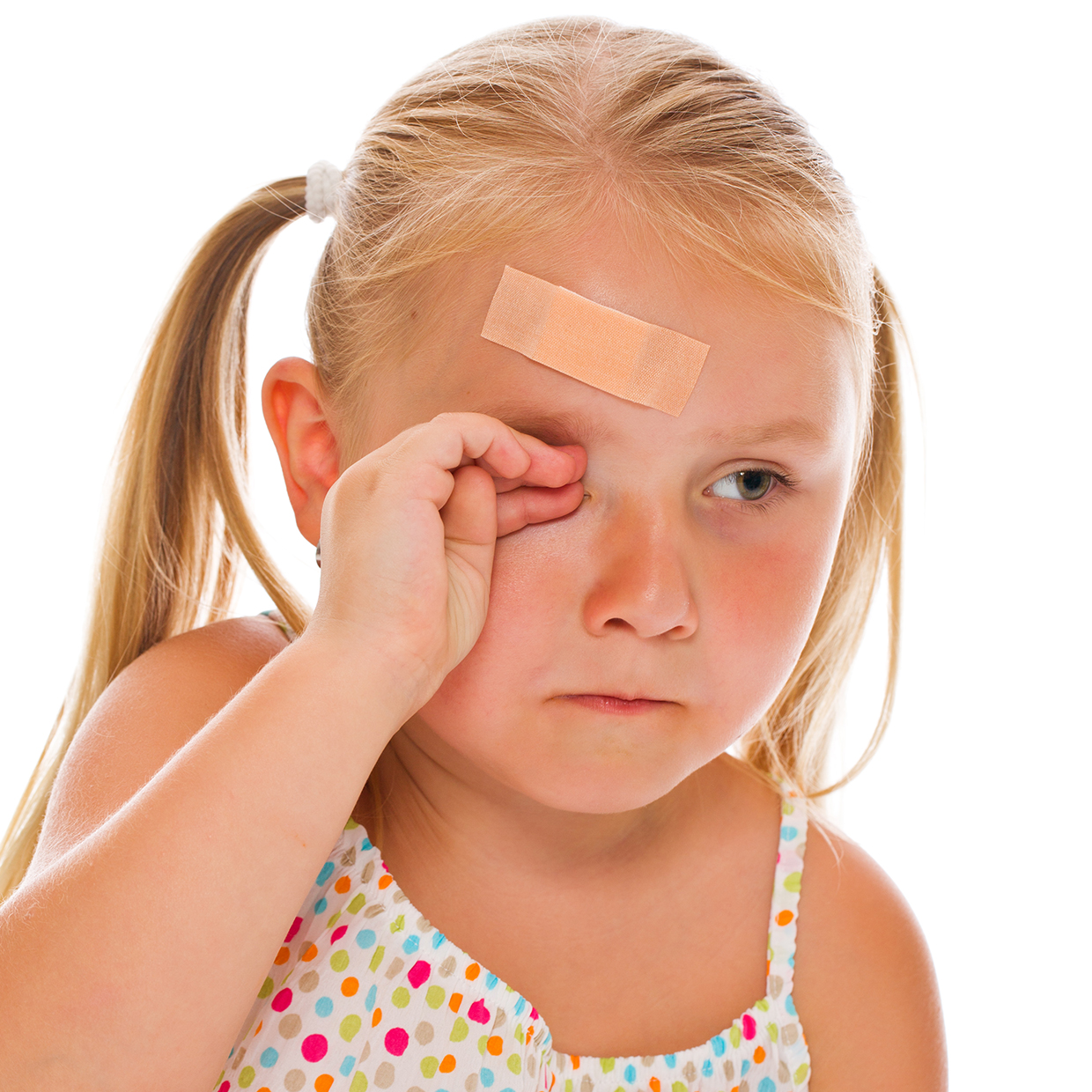 Small girl crying with a band-aid on her forehead
